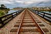 Railroad Crossing the San Dieguito River (Chuck Holland) Tags: railroad carailroadtracks delmarca solanabeach perspective leadinglines bridge tracks californiacoast sandieguitoriver traintracks longview vanishingpoint
