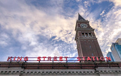 King Street Station (Jeff Carlson) Tags: seattle washington unitedstates us bluesky trainstation wispyclouds urban lookup travel neon sky clocktower kingstreetstation downtown clouds