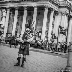 Piping in Trafalgar Square (FotoFling Scotland) Tags: london piper kilt male trafalgarsquare fotoflingscotland olympus lumixg20f17