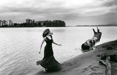 woman at the edge of darkness (nancy_mic) Tags: nancymic nancymicheals oregon beautifulgirl blackandwhite blackwhite redhead bw red dress riverbank thunderstorm portlandor portlandphotographer