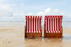 beach chairs and high tide (Cornelia Pithart) Tags: amrum sand beach beachchair flood flooding floodwater germany hightide nopeople northfrisianisland northsea ocean red roofedwickerbeachchair sea sky sunlight water