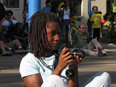 Braided Photographer (Multielvi) Tags: woman girl camera photographer portrait candid washington dc adams morgan day festival street