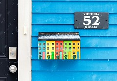52 Victoria Street (Karen_Chappell) Tags: sign mailbox mail post snow snowing snowy house home wood wooden paint painted art number stjohns jellybeanrow rowhouse white blue yellow green red multicoloured colourful colours colour newfoundland nfld canada atlanticcanada eastcoast avalonpeninsula clapboard door downtown city urban