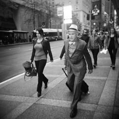 Passenger (Kiyoumars Q. Karimi) Tags: holga ilford hp5 street social documentry suit rush traffic seattle washington passenger bnw bw monochrome lomography