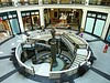 (AmyEAnderson) Tags: milwaukee wisconsin indoors mall open doors historic architecture marble mosaic design triangles circles post support stairwell stairway metal circular winding curved railing landing person people sitting stores storefront pedestrian