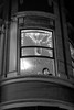 through curved air (Super G) Tags: nikon306 streetphotography candid window curved glass lights twinkle bw blackandwhite sanfrancisco themission victorian