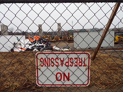 GNISSAPSERT ON! (EX22218 - ON/OFF) Tags: louisville kentucky eastend environment construction sign straw grass fence red white yellow brown orange sediment control erosion soil plywood tower cell health welfare safety letsguide