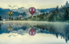 Balloons over Lake Matheson (Jacob Surland) Tags: art balloon caughtinpixels clouds country foxglacier hdr highdynamicrange jacobsurland lake lakematheson landscape mountcook newzealand reflections southisland sunrise time tree trees water wood