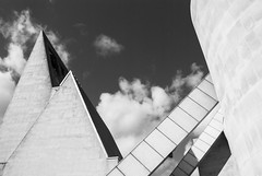 Twin peaks (marktmcn) Tags: architecture liverpool metropolitan cathedral christ king catholic entrance roof roofs butresses walls peaks sky clouds structure building architect frederick gibberd blackandwhite monochrome d80 nikkor 18135mm