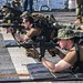 Sailors aim M4A1 at targets during a small arms qualification shoot.