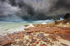 Dark skies and high tides (Louise Denton) Tags: wetseason monsoon darwin nightcliff wet rain storm shower tropical weather nt northernterritory australia beach sea ocean water shore coast cliffs rocks red
