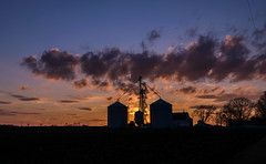 Rural Sunset (tquist24) Tags: elkhartcounty goshen indiana nikon nikond5300 barn clouds evening farm geotagged rural silhouette silhouettes silo silos sky sunset tree trees winter unitedstates
