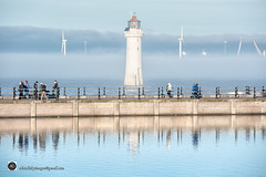 The deep blue scene. (alundisleyimages@gmail.com) Tags: newbrighton wirral wallasey lighthouse rivermersey marinepoint people reflections water weather portsandharbours windfarm mist fog shipping northwestengland winter cold cranes liverpoolcontainerterminal clouds sky sunlight railings seadefence
