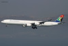 South African Airways (SA/SAA) / A340-642 / ZS-SNA / 01-30-2014 / HKG (Mohit Purswani) Tags: zssna sa saa southafrica southafricanairways a340 a340600 a346 airbus airbusa340 airbusa340600 hkg hkia clk vhhh hongkong widebody civilaviation commercialaviation planespotting aviationphotography landing arrival finalapproach hazer 7d canon airlines aircraft aviation planes