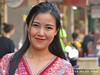 2018-02a Bangkok Chinatown (04) (Matt Hahnewald) Tags: matthahnewaldphotography facingtheworld head face eyes catchlights eyebrows beautifuleyes mouth lips lipstick hair longhair consent emotion fun affection travel culture lifestyle enjoyment beauty chinesenewyear yaowarat cultural roadside celebration festival urban chinatown bangkok thailand thai oneperson female young woman image photo background faceperception nikond3100 primelens 50mm 4x3 horizontal street portrait closeup headshot outdoor color colorful posing authentic smiling grinning beautiful friendly attractive happy pretty charming fabulous nikkorafs50mmf18g fullfaceview lookingcamera expression