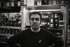 A dangerous man..... (Dafydd Penguin) Tags: portrait dangerous man person london camera exchange blackandwhite blackwhite black white bw monochrome street candid shop assistant shopping bristol west country uk england city urban centre baldwin leicaman leica m10 summicron 35mm f2 asph