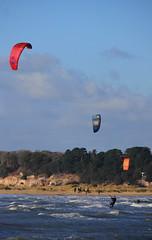 Board Surfing (karen.mear) Tags: boardsurfing shellbay studland surf colour sea man surfer cold wet canon windy wintersun bluesky coastal trees redphonebox