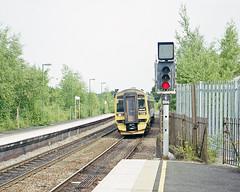 Romsey Station, June 2003 (Ian D Nolan) Tags: station lswr romseystation 35mm epsonperfectionv750scanner railway dhmu class158 sprinter 158749