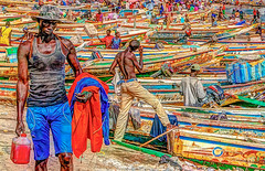 Fishing boats returning at Soumbedioune Fish Market in Dakar (stevebfotos) Tags: people hdr photomatix senegal fishmarket dakar