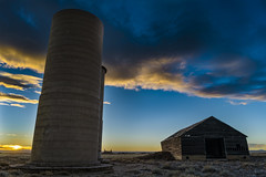 Barn and Two Silos (Tom Herlyck) Tags: colorado sunset old abandoned silos sky farm barn weather clouds amazing plains greatamericandesert prairie southeasterncolorado crowleycounty southerncolorado easterncolorado neglected sun