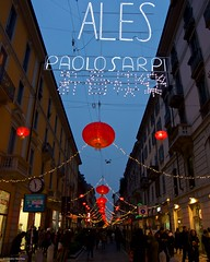 IMGP3270 Decorations for the Chinese new year (Claudio e Lucia Images around the world) Tags: chinatown chinesenewyear chinesecalendar paolo sarpi viapaolosarpi milano redlamps reddistrict redlanterns newyear lights pentax pentaxk5 pentax18135 persone insegna albero