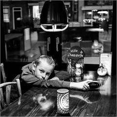 A little bit bored (John Riper - AWAY FOR AWHILE) Tags: johnriper street photography straatfotografie rotterdam square bw black white zwartwit mono monochrome netherlands fryslân friesland john riper fuji fujifilm xt2 xf23mm boy bored pub reflections