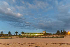 Wamberal Surf Life saving Club from the Beach (Merrillie) Tags: daybreak sunrise shellybeach nature australia surf centralcoast morning newsouthwales waves earlymorning nsw sea beach ocean sky clouds landscape coastal cloudy outdoors seascape waterscape coast water dawn