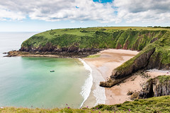Pembrokeshire Coast (Keith in Exeter) Tags: pembrokeshire coast nationalpark wales skrinklehaven churchdoors arch bay sea water sand beach cliff clifftop surf boat landscape coastal geology erosion