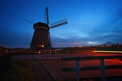 De Tweede Broekermolen te Uitgeest at sunset (l.cutolo) Tags: tlp clouds ngc hdr netherlands colours digitalblending landscape uitgeest longexposure windmill dusks night ononesoftware cartrails worldtrekker flickr aperture sunset molen detweedebroekermolen lights sonyfe1635mmf28gm