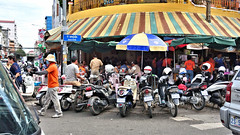 Busy Breakfast (CAMBODIA) (ID Hearn Mackinnon) Tags: breakfast busy phnom penh cambodia cambodian 2017 south east asia asian people culture society motorbikes motorcycle packed pack street awning travel tourism