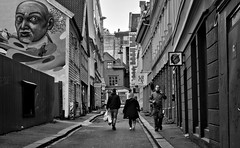 A Street (Anne Worner) Tags: anneworner em5 nik olympus silverefex architecture bw blackandwite buildings candid man people street streetart streetphotography urban walking walls woman bergen norway perspective city downtown graffiti urbanart