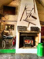 Pub Paraphernalia (JulieK (thanks for 7 million views)) Tags: pub churn green fire signs pram old arthurstownbrewingcompany wexford ireland irish iphonese hww wackyweekends 2018onephotoeachday wall farmimplements tools