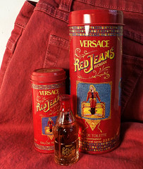 Red Jeans (Durley Beachbum) Tags: odc red perfume glass metal stilllife bottle tin versace