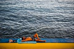 Sunshine Man - Calheta, Madeira (Sebastian Bayer) Tags: olympus meer sonne sonnenuntergang mann atlantik madeira sonnen portugal drausen calheta strand omdem5ii person street omd mauer wellen wasser handtuch urlaub