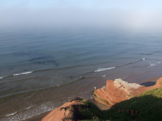 Orcombe Point, Exmouth, with dissolving sea fog beyond