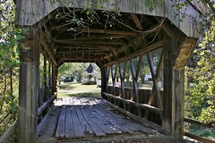 Covered Bridge (outdoorpict) Tags: coveredbridge wooden decaying sunshine village authenticbuilding gazebo greens shrubs branches