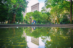 A Day in the Life (Thomas Hawk) Tags: america flatiron flatironbuilding fullerbuilding manhattan nyc newyork newyorkcity usa unitedstates unitedstatesofamerica architecture park reflection