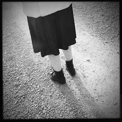 IMG_2564_achromaties©jp_nogues (noguesjeanpaul) Tags: square carré shoes chaussures woman femme chemin path cailloux stones jupe skirt