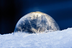 Frozen Soap Bubble (Jon Ariel) Tags: water ice frozen macro blue