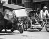 Smoking (Beegee49) Tags: smoking cigarette tricycle traffic bacolod city philippines