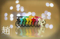 Spokey Bokeh (mikechiu86) Tags: lego minifigure collectible rainbow bicycles bikes sparkly lights glittery twinkly microlights vignette reflection reflective bokeh