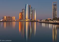 Sunrise on Etihad Towers in Abu Dhabi (Jhopne) Tags: jan18abudhabiuae sky cityscape water marina towers building boat abudhabi canonef2470mmf28lusm canoneos5dmarkii city sundaylights
