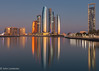 Sunrise on Etihad Towers in Abu Dhabi (Jhopne) Tags: jan18abudhabiuae sky cityscape water marina towers building boat abudhabi canonef2470mmf28lusm canoneos5dmarkii city sundaylights
