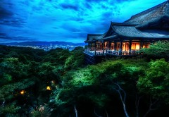Temple on a hill (Stuck in Customs) Tags: treyratcliff stuckincustoms stuckincustomscom japan kyoto temple architecture hdr hdrtutorial hdrphotography hdrphoto portfolio tree hill night sunset dusk lights orange green blue clouds
