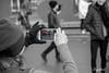 Tourist in Amsterdam. (Digifred.) Tags: digifred 2018 amsterdam nikond500 nederland netherlands holland iamsterdam straat street city grachten streetphotography blackwhite blackandwhite separatecolor monochrome toeristen selectivecolor candid girls tourist museumplein mobilephone cellphone iphone smartphone