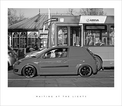 Waiting at the lights (Parallax Corporation) Tags: candid blackwhite sportscar boxerdog passenger traffic monochrome streetphotography