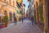 Via Faenza, Florence (Ray in Manila) Tags: florence italy eos650d efs24mm street leisureandtravel streetphotography cinema restaurant cobblestone colourful people historic architecture bicycle buildings