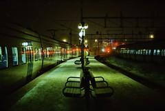 green and red on the platform in södertälje c (Mister.Marken) Tags: södertälje night platform train nikonf4 digibasec41 madeinsweden kodakcolorfilm red