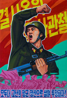 North Korean propaganda poster depicting a soldier, Pyongan Province, Pyongyang, North Korea