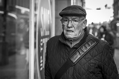 Due Consideration (Leanne Boulton) Tags: portrait urban street candid portraiture streetphotography candidstreetphotography candidportrait streetportrait eyecontact candideyecontact streetlife closeup old elderly man male face eyes mouth expression look emotion feeling mood hat cap winter tone texture detail depthoffield bokeh naturallight outdoor light shade shadow city scene human life living humanity society culture people canon canon5d 5dmkiii character 70mm ef2470mmf28liiusm black white blackwhite bw mono blackandwhite monochrome glasgow scotland uk